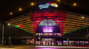 The front entrance of Holland Casino Scheveningen, The Hague, Netherlands, lit up at night.