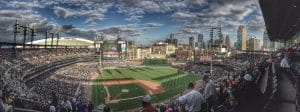 Comerica Park, the home field of the Detroit Tigers with Ford Field football stadium to the left and the Detroit skyline to the right.