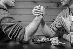 Men betting on arm-wrestling