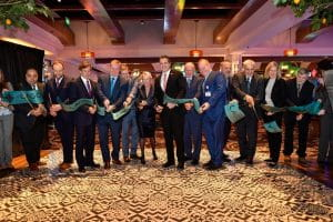 Officials and representatives are cutting the ribbon at the grand opening of the Casino Resort in New York