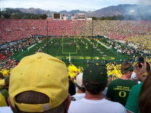 Oregon football fans watching the Oregon marching band perform during halftime of a Rose Bowl game