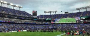 People gathering on the field of M & T Bank Stadium, home of the Baltimore Ravens.