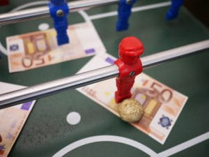 Football table with money on it