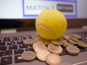 Laptop, coins and a tennis ball
