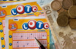 Lottery ticket, pencil, and money on a table