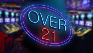 A Sign Saying Over 21 with Slots in the Background