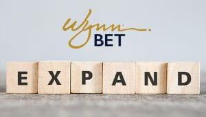 Logo WynnBet Di Atas Kata Diperluas Ditulis dengan Huruf Scrabble
