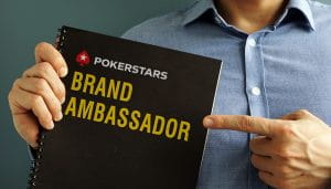 A Notebook with PokerStars Logo and Brand Ambassador Sign